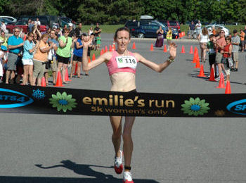 Mary Davies breaks the tape to set a new course record of 17:08 in the Emilie Mondor Memorial 5K Race for Women