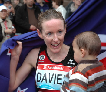 Mary Davies with her son after running 2:28:56.6 to win the Toronto Waterfront Marathon