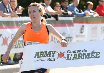 Rebecca Stallworth of the OAC Racing Team, the top female finisher in the Army Run Half-Marathon in 1:23:03. Photo: Mike Pinder Photography