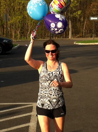 Lisa doing 50M strideouts with her 50th Birthday Balloons.