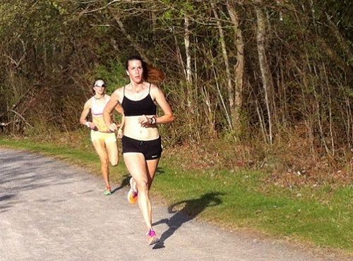 Nadine and Stacey finishing a 400 along the Rockcliffe Park path.