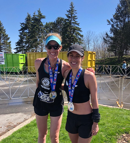Rachel Schmidt  and Erin Mayo after running PBS at the Mississauga Marathon.